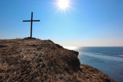 Cross on sea cape Stock Image