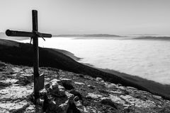 Cross and sea of fog Royalty Free Stock Photography
