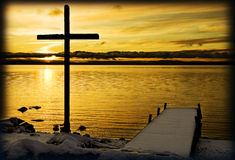 Cross with seaview in Sweden stock photography