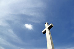 Cross section. An image of a concrete crucifix against a blue sky stock photography