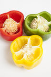 Cross section of different colored bell peppers Royalty Free Stock Photo