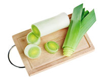 Cross-section of green leek on wooden board Stock Image