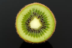 Kiwi Fruit Cross Section on Black Background Stock Photo