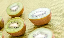 Cross section kiwifruits. On the green background Royalty Free Stock Photo