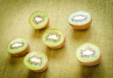 Cross section kiwifruits. On the green background Stock Photos