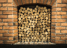 Cross section of pine logs ready for winter in the fireplace Royalty Free Stock Photo