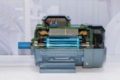 Cross section present inside of industrial electric motor at factory storage stock images