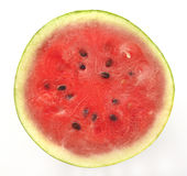 Cross Section of  Red Water Melon with Black Seeds Stock Image
