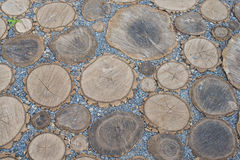 Cross section of a tree abstract background. Playground lined with wooden dies and gravel Royalty Free Stock Photos