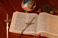 Cross shadow and bible Stock Photos