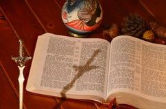 Cross shadow and bible Stock Photos
