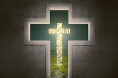 Cross shape with christ symbol with christmas lights decoration Stock Photography