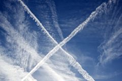 Cross shape created in the sky by planes Stock Photos