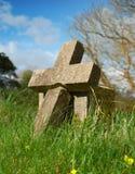 Cross shaped grave stone stock photos