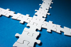 Cross-shaped jigsaw puzzle. Royalty Free Stock Photo