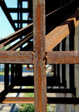 A cross shaped metal construct made of rusty angle sections connected by welding Stock Photography