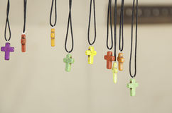 Cross shaped pendants Stock Images