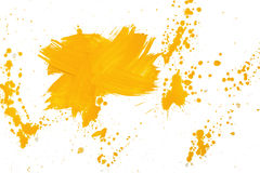 Cross shaped strokes with yellow gouache forming spots on a white canvas Royalty Free Stock Images