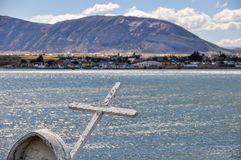 Cross on the shore, Puerto Natales, Patagonia, Chile. A white cross in the shore in Puerto Natales, Patagonia, Chile stock image