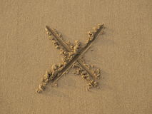 Cross sign drawn on sand Stock Images