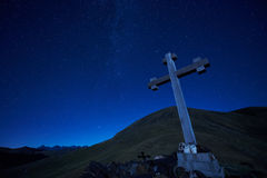 Cross sign on the mountain peak pass at night Stock Images