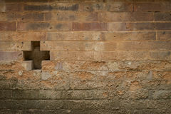 Cross sign on old brick wall Stock Images