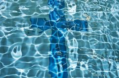 Cross Sign In Swimmingpool Stock Photo