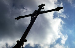 Cross silhouette. A roadside cross in the countryside in Poland Royalty Free Stock Photos