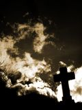 Cross silhouette. With clouds_in backlight Royalty Free Stock Photography