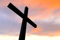 Cross silhouette and the clouds. Cross in silhouette with a colorful sky and cloud Stock Photography