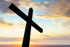 Cross silhouette and the clouds. Cross in silhouette with a colorful sky and cloud Stock Image
