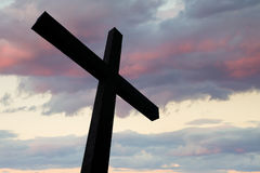Cross silhouette and the clouds. Cross in silhouette with a colorful sky and cloud Stock Images