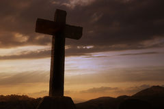 Cross silhouette. And the clouds at sunset Royalty Free Stock Photos