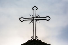 Cross in silhouette Stock Image