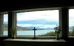 Cross silhouette and lake. Cross silhouette and a New Zealand lake Royalty Free Stock Images
