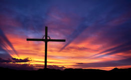 Cross silhouette on the mountain at sunset. Silhouette of Christian cross at sunrise or sunset panoramic view stock images