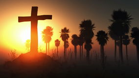 Cross silhouette with palms and glowing sun stock footage