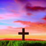 Cross silhouette in sunset Stock Image
