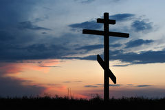 Cross silhouette with the sunset Stock Photos