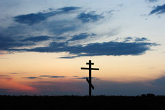 Cross silhouette with the sunset Royalty Free Stock Images