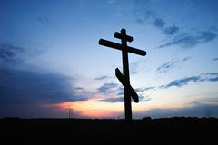 Cross silhouette with the sunset Royalty Free Stock Image