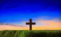 Cross silhouette with sunset background. Cross silhouette on grass with sunset background Stock Photography