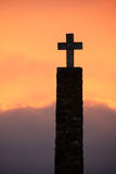 Cross silhouette at sunset time royalty free stock images