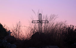 Cross Silhouette inside a field at Sunset royalty free stock photography