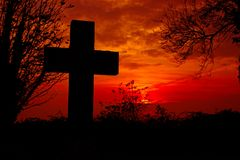 Free Cross Silhouette With Red Sky Background. Royalty Free Stock Images - 130760049