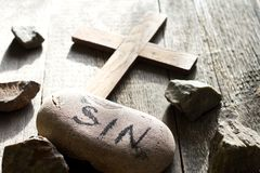 Cross sins and stones abstract easter confession religion background. Concept royalty free stock photo
