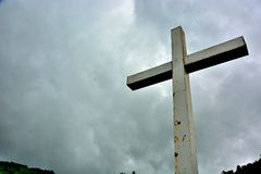 Cross situated on a hill in dramatic clouds. Croix de Maisonne, Cross situated on a hill in dramatic clouds. Vic sur sere, France Royalty Free Stock Photo