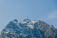 The Cross situated in top of the Caraiman mountain. Royalty Free Stock Image