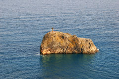 Cross on skerry. Cape Fiolent, Ukraine, Crimea Royalty Free Stock Photography