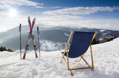 Cross ski and Empty sun-lounger at mountains in winter Royalty Free Stock Photos